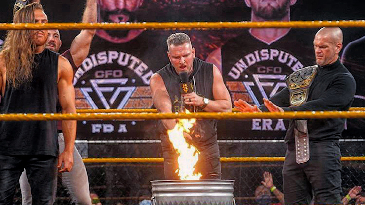 NXT: Pat McAfee sets Undisputed ERA flag ablaze